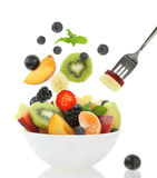 Fresh fruits. Coming out from a bowl royalty free stock photos