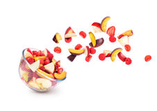 Fresh fruits coming out from a bowl. Isolated on a white background stock photo