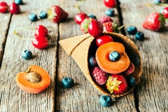 Fresh fruits in cone Royalty Free Stock Photos