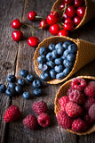 Fresh fruits in cone Stock Images