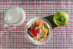 Fresh fruits and corn flakes with milk Stock Photos