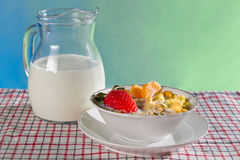 Fresh fruits with corn flakes and milk jug Royalty Free Stock Images