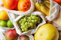 Fresh fruits from market in cotton bags, from above stock photos