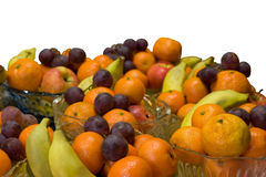 Fresh fruits in crystal vases Stock Images