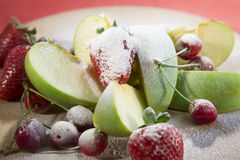 Fresh fruits decorated with powdered sugar. Royalty Free Stock Photo