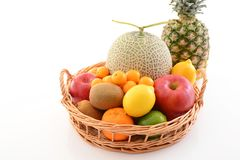 Fresh fruits. Delicious and fresh fruits in basket royalty free stock photos