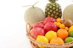 Fresh fruits. Delicious and fresh variety fruits on white background stock image