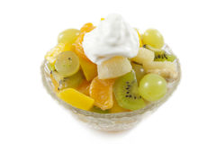 Fresh fruits dessert with whipped cream Stock Images