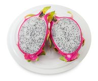 Plate of Fresh Ripe Dragon Fruit on White Background. Fresh Fruits, A Dish of Ripe and Sweet Dragon Fruit or Pitaya Isolated on White Background Stock Photos