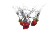Fresh fruits dropped into water with splash Royalty Free Stock Photo