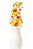 Fresh Fruits Falling Into The Jar With Milk Royalty Free Stock Image