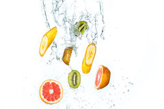 Fresh fruits falling in water splash, isolated on white background Stock Photo