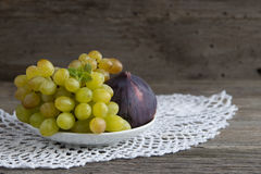 Fresh fruits figs  and grape in plate. Stock Images