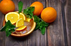 Fresh fruits and fragrant mint leaves, lemon balm. Healthy eating. Close-up. Concept. Orange. stock photos