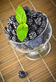 Fresh fruits in glass goblet with mint leaf Royalty Free Stock Photos