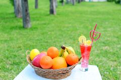 Fresh fruits. With a glass of juice royalty free stock photography