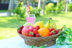 Fresh fruits. With a glass of juice royalty free stock images