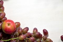 Fresh fruits grapes, pear and apple on wooden boards frame background. Fresh fruits grapes, pear and apple on wooden boards frame background Royalty Free Stock Photos