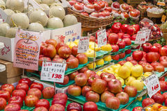 Fresh fruits in a greengrocery. Osaka, Japan - October 26, 2014: Fresh fruits in a greengrocery in Kuromon Market in Osaka, Japan. The Kuromon Market has been Stock Photography