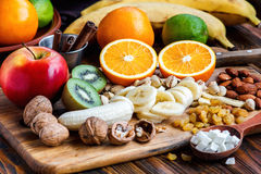 Fresh fruits. Healthy food. Mixed fruits and nuts background.Healthy eating, dieting, love fruits. Studio photography of different fruits and nuts on old Stock Photo