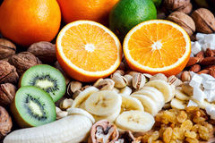 Fresh fruits. Healthy food. Mixed fruits and nuts background.Healthy eating, dieting, love fruits. Stock Images