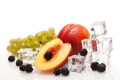 Fresh fruits with ice cubes Royalty Free Stock Photography