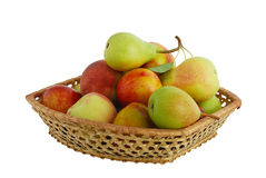 Fresh fruits in interwoven basket. Fresh pears, peaches and nectarines in interwoven basket isolated on white background Royalty Free Stock Photography