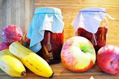 Fresh fruits and jars on wooden background Royalty Free Stock Images