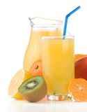 Fresh fruits juice in glass and slices Royalty Free Stock Image