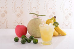 Fresh fruits with juice. Fresh fruits at the table Royalty Free Stock Image