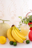 Fresh fruits with juice. Fresh fruits at the table Royalty Free Stock Images