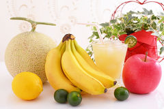 Fresh fruits with juice. Fresh fruits at the table Stock Photos
