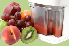 Fresh fruits and juicer Royalty Free Stock Photo