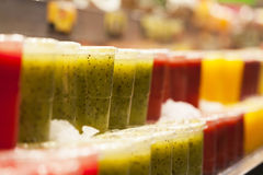 Fresh fruits juices exposed Stock Photos