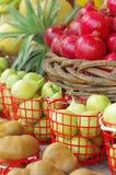 Fresh fruits. Kiwis, apples and pomegranates at the market stock image