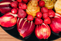 Fresh fruits. Lie on a wooden table Stock Image