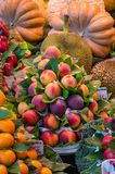 Fresh fruits, market stall, food background. Fresh ripe juicy fruits and vegetables at a local la Boqueria market in Barcelona, Spain royalty free stock image