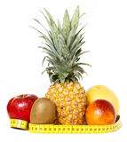 Fresh fruits with measuring tape isolated Stock Images