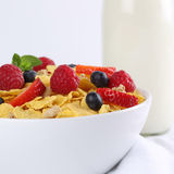Fresh fruits with milk and cornflakes for breakfast. Fresh fruits like strawberries with milk and cornflakes for breakfast Stock Photography