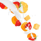 Fresh fruits in milk splash. Over white background Stock Photo