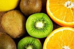 Fresh fruits mix. Juicy kiwi fruit and oranges close-up as a natural background stock image