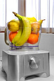 Fresh fruits in the mixer Stock Images