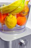 Fresh fruits in the mixer Royalty Free Stock Photography