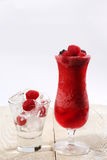 Fresh fruits and natural juice, glass of ice cubes stock photo