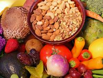 Fresh fruits, nuts and vegetables royalty free stock photo
