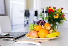 Fresh fruits on office table Royalty Free Stock Photos