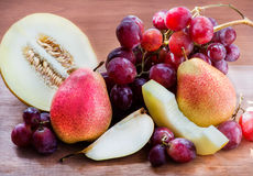 Fresh fruits over wooden  background Stock Images