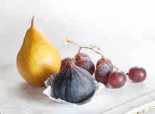 Fresh fruits. Pear, fig and grapes. Accompaniments for cheese royalty free stock image