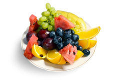 Fresh fruits on plate Royalty Free Stock Images