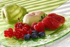 Fresh fruits on a plate. Fresh fruits on a glass plate Stock Photography